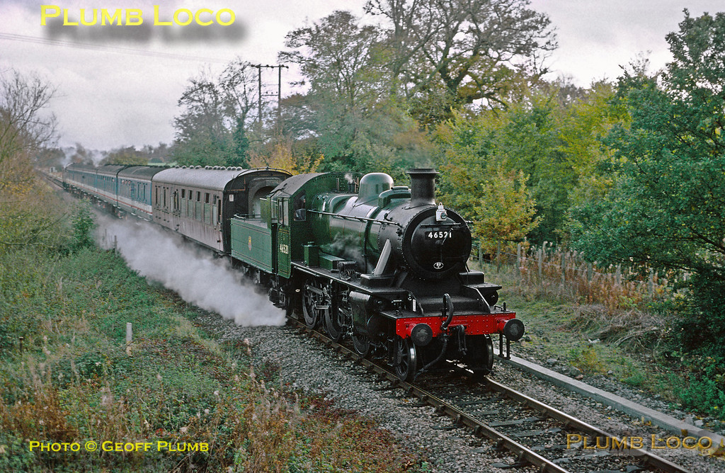 Carrying an 89C (Machynlleth) shedcode plate, LMS Ivatt 2MT 2-6-0 No. 46521 is at work between Twyford and Wargrave on the branchline to Henley-on-Thames during festivities arranged by Network SouthEast, with 37411 on the rear of the train. Sunday 1st November 1992. Slide No. 22973.