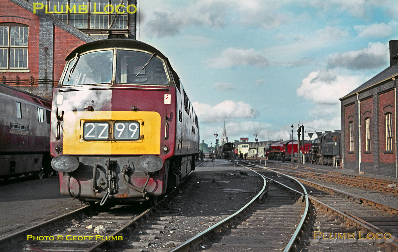 """""""Western"""" Class 52 C-C diesel hydraulic No. D1018 """"Western Buccaneer"""" sits outside Swindon Works alongside classmate D1013 """"Western Ranger"""" (now preserved), both carrying BR Maroon livery. Also in maroon livery in the background is LMS Stanier """"Coronation"""" class 4-6-2 No. 46251 """"City of Nottingham"""" which was visiting with an RCTS railtour from Nottingham. Ivatt 4MT 2-6-0 No. 43056 is also in the background. Saturday 9th May 1964. Slide No. 675."""